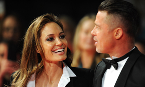 Angelina Jolie and Brad Pitt smoulder in matching tuxedo outfits at the BAFTAs